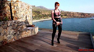 Mature British redhead masturbates on the balcony