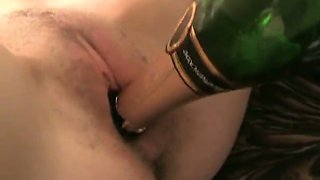 Leggy pale blonde nympho pets her hungry twat with a bottle neck