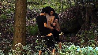 Slender Asian slut in stockings enjoys a threesome outside