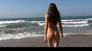 amazing baby getting naked on the beach