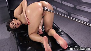 Busty machine babe gets her ass stretched