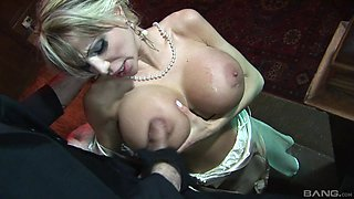 Busty blonde hottie takes care of a big load of hard pecker