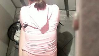 Slender white brunette teen with skinny as filmed from above in the toilet